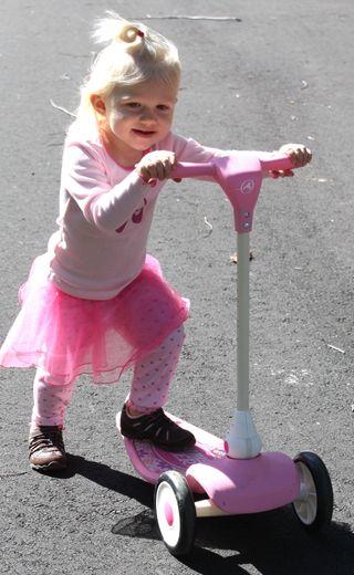 Hazel in tutu on scooter