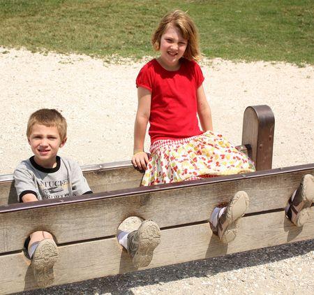 Kids in foot stocks