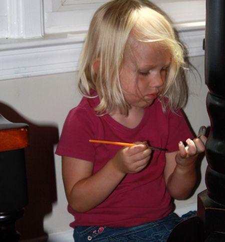 Hazel painting hands