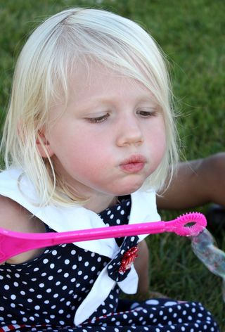 Hazel blowing bubbles