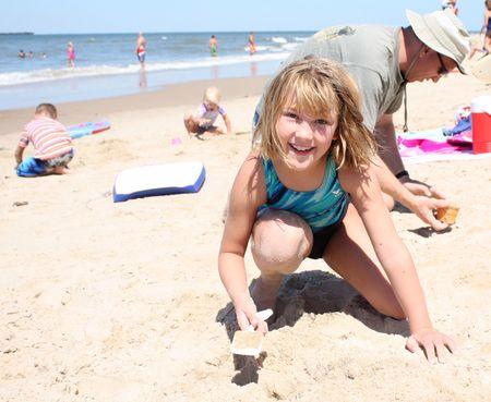 Eliza, family in sand