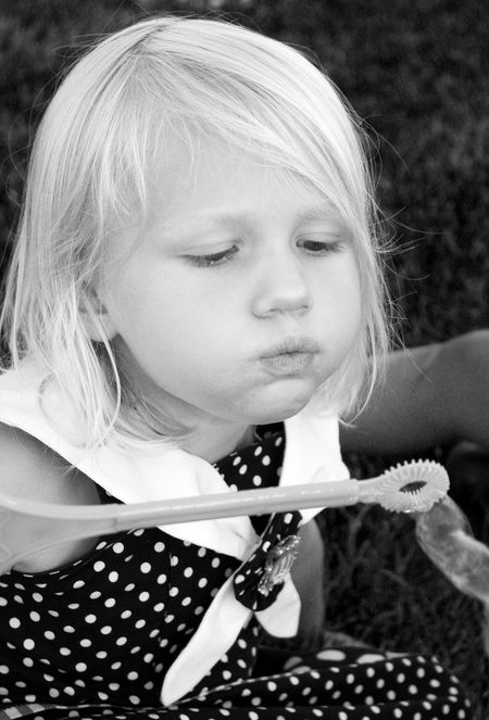 Hazel-blowing-bubbles-bw