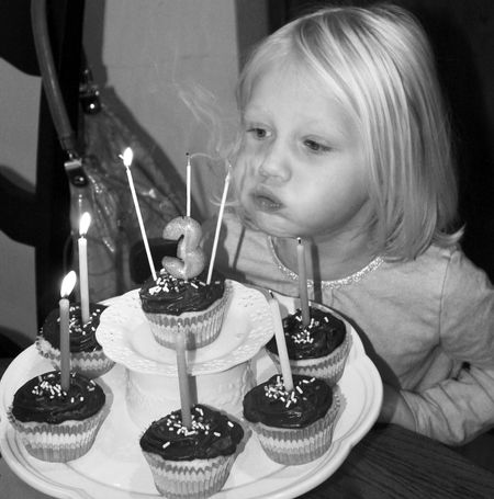 Hazel-blowing-out-candles-bw