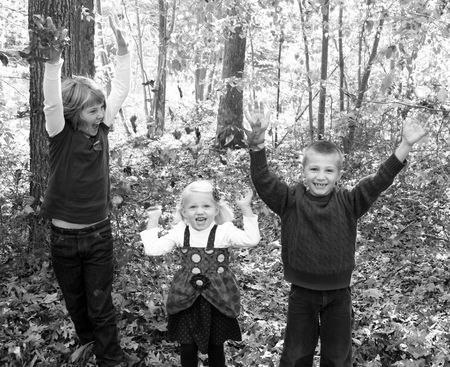 Kids-in-leaves1-cropped-bw
