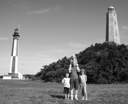 Family-at-2-lighthouses,-Fort-Story-bw