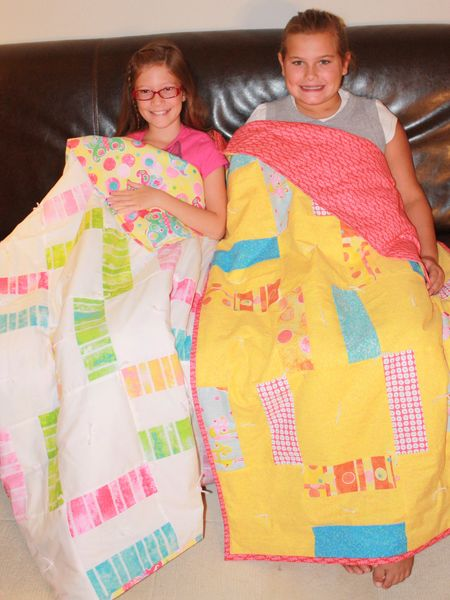 Girls with quilts
