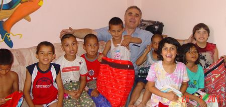 Nickolai with orphans and bags2