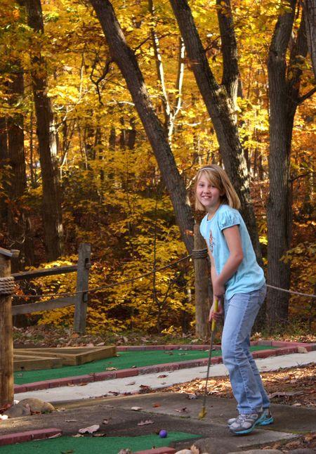 Eliza golfing
