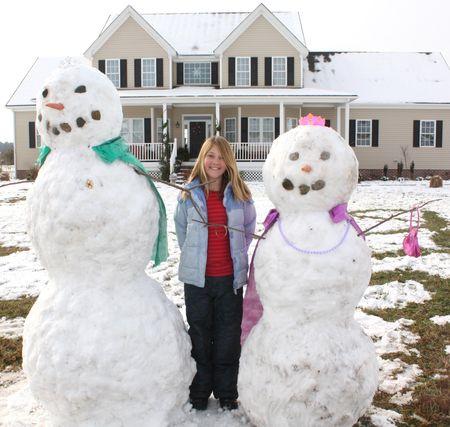 Eliza with snowmen